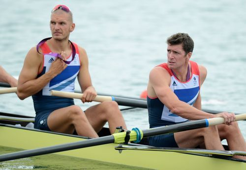 Rex Features via AP Images Greg Searle of Great Britain and team-mate Mohamed Sbihi, left, row away Wednesday after receiving their bronze medals for the Rowing Men's Eight at the 2012 London Olympic Games.