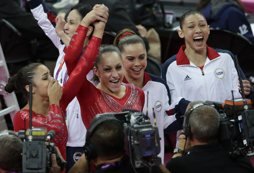 Gregory Bull  |  The Associated Press U.S. gymnasts, from left to right, Alexandra Raisman, Jordyn Wieber, McKayla Maroney and Kyla Ross celebrate after being declared winners of the gold medal during the Artistic Gymnastic women's team final at the 2012 Summer Olympics, Tuesday, July 31, 2012, in London.