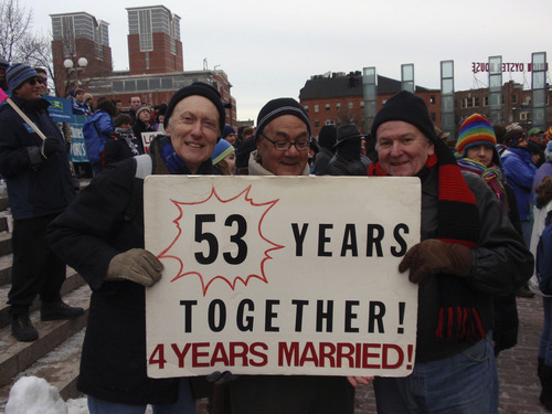 Courtesy photo Rep. Barney Frank (center) with two men celebrating their fourth wedding anniversary in Boston. The couple were able to legally marry in Massachusetts after 47 committed years together. The photograph was made by Jim Ready, who became Frank's spouse in June 2012.