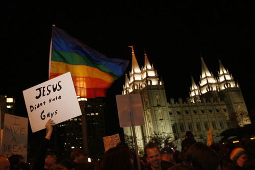 Chris Detrick | The Salt Lake Tribune Marchers outside of Temple Square along North Temple Street in this archive photo from Nov. 7, 2008. An estimated 2,000 people gathered to protest Mormon church officials campaigning on behalf of California's Proposition 8.