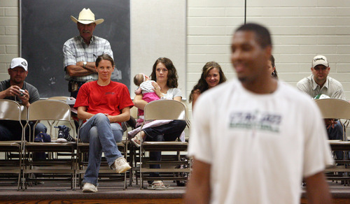 Steve Griffin | The Salt Lake Tribune   Parents watch from the sidelines as Utah Jazz forward, Derrick Favors,  visits Tabiona, Utah and their Junior Jazz program Monday July 30, 2012.
