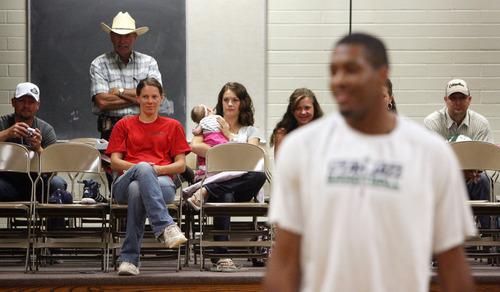 Steve Griffin | The Salt Lake Tribune   Parents watch from the sidelines as Utah Jazz forward, Derrick Favors,  visits Tabiona, Utah and their Junior Jazz program Monday July 30, 2012.