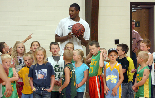 Steve Griffin | The Salt Lake Tribune   Kids line up with Utah Jazz forward, Derrick Favors, after they here asked whose team they want to play on during the Jazz player's visit to  Tabiona, Utah and their Junior Jazz program Monday July 30, 2012.