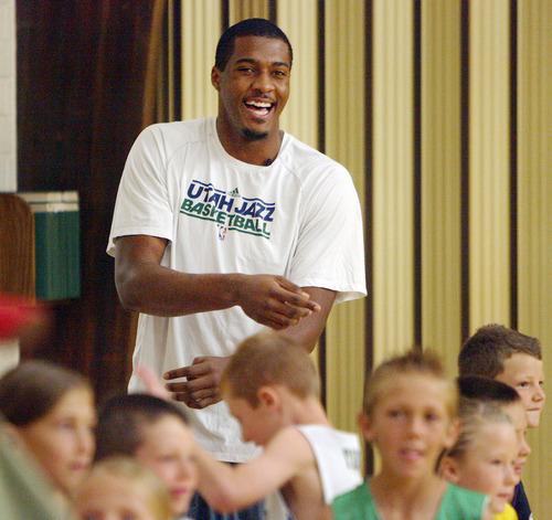 Steve Griffin | The Salt Lake Tribune   Utah Jazz forward, Derrick Favors, laughs with kids during his visit to  Tabiona, Utah and their Junior Jazz program Monday July 30, 2012.