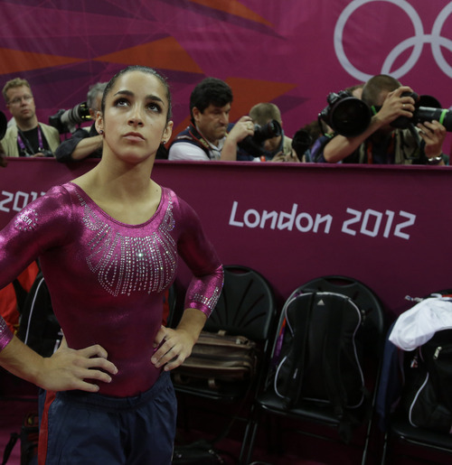 U.S. gymnast Alexandra Raisman looks up towards the display screen after final results were declared for the artistic gymnastics women's individual all-around competition at the 2012 Summer Olympics, Thursday, Aug. 2, 2012, in London. (AP Photo/Julie Jacobson)