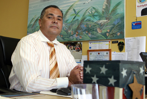 In this July 5, 2012, photo, retired police officer Hector Rodriquez sits in his office in Kissimmee, Fla. Rodriguez is a self-described fiscal conservative and a military hawk, with one son in the Army and another in the Coast Guard. When it comes to social issues, though, the longtime Republican is moderate enough to have cast votes for Democratic Presidents Bill Clinton and Barack Obama. A native of Puerto Rico, Rodriguez is undecided this go-round. He and like-minded Puerto Ricans living in the I-4 corridor, a wide swath of central Florida lined with amusement parks, are drawing unprecedented attention from the presidential campaigns. (AP Photo/John Raoux)
