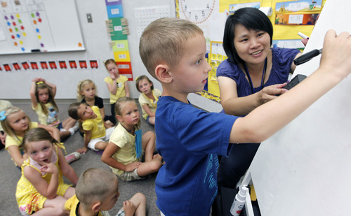 Al Hartmann  |  The Salt Lake Tribune   The Jordan School District has seen interest in its dual immersion language programs skyrocket. Pei Chi Chang teaches first- graders  a counting excercise in the Chinese language program at Foothills Elementary in Riverton.