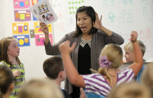 Al Hartmann  |  The Salt Lake Tribune    Yufang Huang, a first year teacher from Taiwan, leads a third grade class in a lively excercise in Chinese in the dual immersion program at Foothills Elementary in Riverton.   By third grade students are comfortable reading and speaking the language.