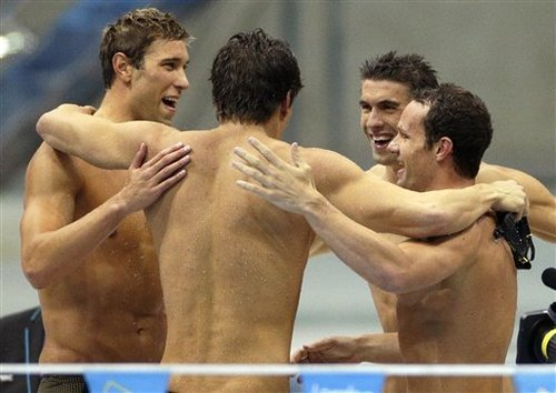 United States' men's 4 X 100-meter medley relay team from left, Matthew Grevers, Nathan Adrian, Michael Phelps and Brendan Hansen embrace after winning the gold medal at the Aquatics Centre in the Olympic Park during the 2012 Summer Olympics in London, Saturday, Aug. 4, 2012. (AP Photo/Michael Sohn)