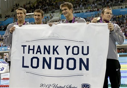 United States' men's 4 X 100-meter medley relay team from left, Matthew Grevers, Michael Phelps, Nathan Adrian and Brendan Hansen pose with a banner thanking London after their gold medal win in the men's 4 x 100-meter medley relay at the Aquatics Centre in the Olympic Park during the 2012 Summer Olympics in London, Saturday, Aug. 4, 2012. (AP Photo/Lee Jin-man)