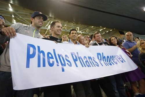 U.S swimmer Michael Phelps' family hold a banner up as he swims in the 4 x 100-meter medley relay final at the Aquatics Centre in the Olympic Park during the 2012 Summer Olympics in London, Saturday, Aug. 4, 2012. (AP Photo/Jae C. Hong)