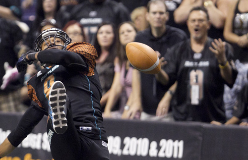 PNI0805-spt rattlers  073012419tk   --  8/4/12- Arizona Rattlers WR Markee  White (CQ) fumbles a kick off return that was then recovered by the  Utah Blaze during the second quarter of Saturday's playoff game at U.S. Airways Center. Pat Shannahan/The Arizona Republic