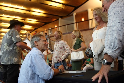 Kim Raff | The Salt Lake Tribune Jon Krakauer signs books for (right) Rick Luskin and Loree DeYoung before he participated in a Utah Film Center panel discussion about adapting investigations into extreme religious groups into documentaries and dramatic fiction films at the Rose Wagner Performing Arts Center in Salt Lake City on Sunday, Aug. 5, 2012.