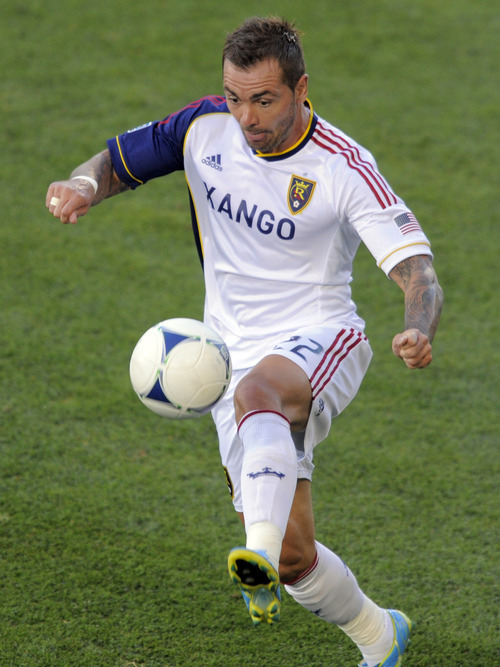 Real Salt Lake midfielder Jonny Steele controls the ball against the Colorado Rapids during the first half of an MLS soccer game in Commerce City, Colo., Saturday, Aug., 4, 2012. (AP Photo/Jack Dempsey)