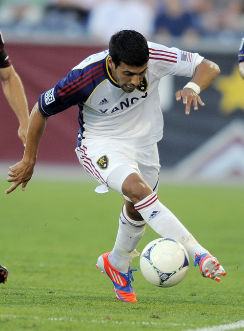 Real Salt Lake midfielder Javier Morales controls the ball against the Colorado Rapids during the first half of an MLS soccer game in Commerce City, Colo., Saturday, Aug., 4, 2012. (AP Photo/Jack Dempsey)
