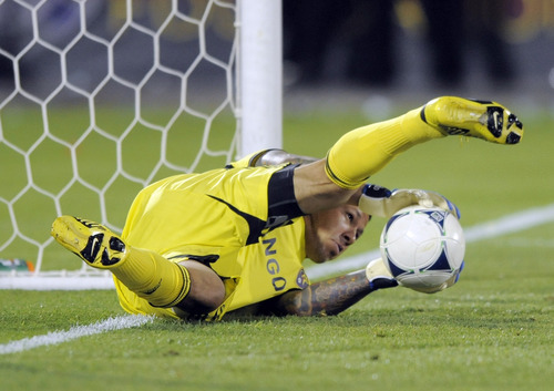 Real Salt Lake goalkeeper Nick Rimando blocks a shot against the Colorado Rapids during the second half of an MLS soccer game in Commerce City, Colo., Saturday, Aug., 4, 2012. Colorado defeated Real Salt Lake 1-0. (AP Photo/Jack Dempsey)