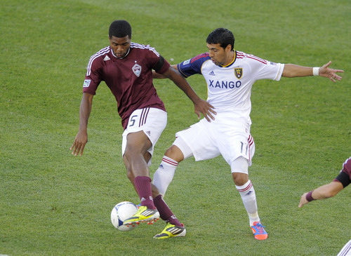 Colorado Rapids' Joseph Nane (5) and Real Salt Lake midfielder Javier Morales (11) go after the ball during the first half of an MLS soccer game in Commerce City, Colo., Saturday, Aug., 4, 2012. (AP Photo/Jack Dempsey)