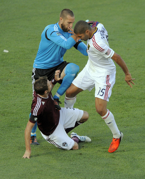 Colorado Rapids goalkeeper Matt Pickens, top left, pulls Real Salt Lake forward Alvaro Saboru (15) off Drew Moor, bottom left, during an altercation in the first half of an MLS soccer game in Commerce City, Colo., Saturday, Aug., 4, 2012. (AP Photo/Jack Dempsey)