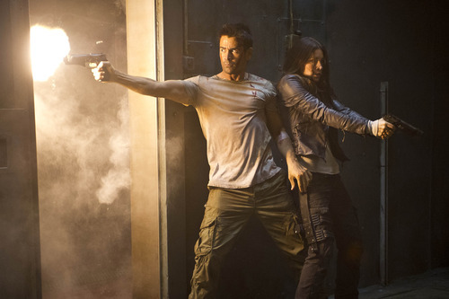 Courtesy Michael Gibson  |  Columbia Pictures Doug (Colin Farrell) and Melina (Jessica Biel) have to shoot their way out of trouble in the sci-fi thriller