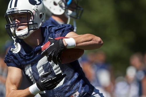 Chris Detrick  |  The Salt Lake Tribune BYU's Mitch Mathews runs the ball during a preseason practice at the BYU outdoor practice field Thursday August 2, 2012.