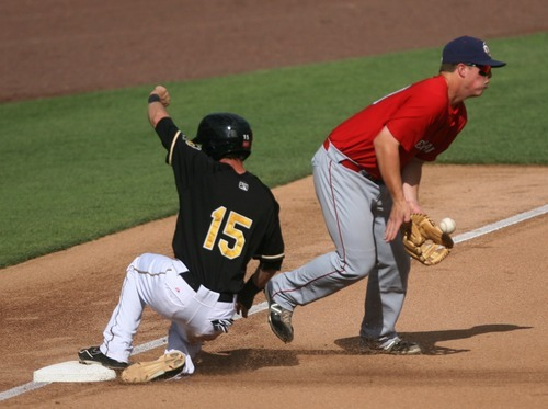 Kim Raff | The Salt Lake Tribune Salt Lake Bees player Matt Long slide in safely at third after tagging up as Oklahoma City Redhawks player Matt Dominguez catches the late throw at Spring Mobile Ballpark in Salt Lake City, Utah on August 5, 2012.