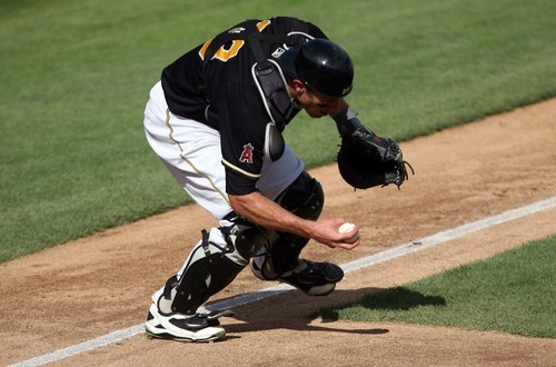 Kim Raff | The Salt Lake Tribune Salt Lake Bees catcher John Hester grabs a bunt hit by the Oklahoma City Redhawks at Spring Mobile Ballpark in Salt Lake City, Utah on August 5, 2012.