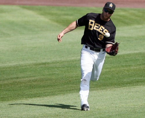 Kim Raff | The Salt Lake Tribune Salt Lake Bees outfielder Trevor Crowe catches a fly ball during a game against Oklahoma City Redhawks at Spring Mobile Ballpark in Salt Lake City, Utah on August 5, 2012.