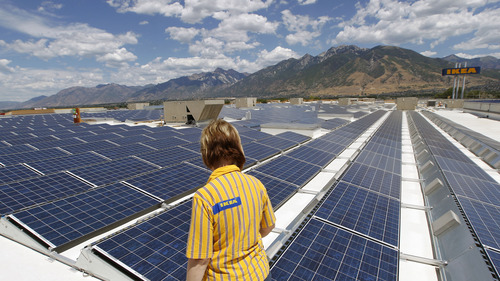 Al Hartmann  |  The Salt Lake Tribune   Celeste Ledesma, marketing and public relations officer for Ikea walks through some of the hundreds of solar panels installed on the store's roof in Draper on Thursday July 26.   The solar energy system is up and running.  The company bills the array as the state's largest private commercial solar project. The 180,500-square-foot photo voltaic array consists of a 1,015 kw system built with 4,228 panels.