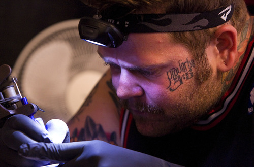 Scott Sommerdorf  |  The Salt Lake Tribune              Artist Justin Wilson of Dayton, Ohio works on a tattoo for Tori Neilson at the first annual Park City Tattoo Convention at the Yarrow Hotel, Sunday, August 5, 2012.