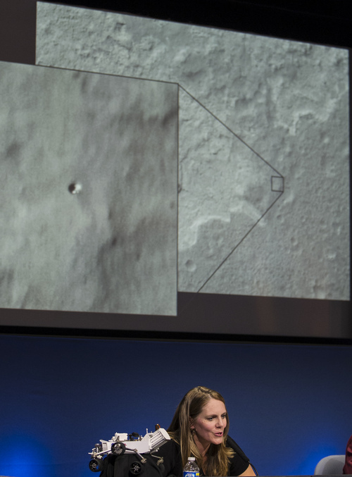 Jennifer Trosper, Mars Science Laboratory, MSL mission manager, JPL, shows an image from Mars during a news briefing on the last data and imagery from Sol 1 at NASA's Jet Propulsion Laboratory in Pasadena, Calif., Monday, August 6, 2012. (AP Photo/Damian Dovarganes)