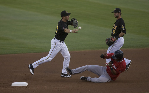 Kim Raff   The Salt Lake Tribune (left) Salt Lake Bees Ed Lucas attempts a double play after tagging Oklahoma City Redhawks player Jimmy Paredes out at second during a game at Spring Mobile Ballpark in Salt Lake City, Utah on August 6, 2012.
