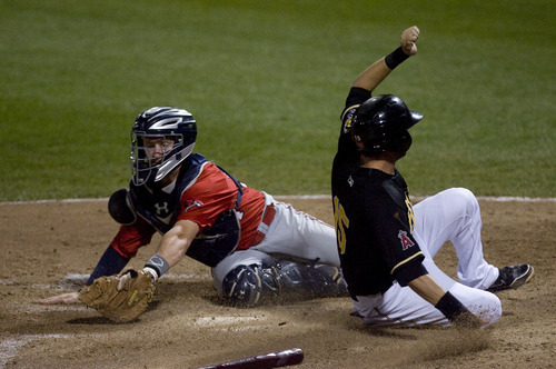 Kim Raff   The Salt Lake Tribune Salt Lake Bees player Matt Long beats the tag by Oklahoma City Redhawks catcher Chris Wallace to tie the game at 3-3 during the bottom of the 7th inning during a game at Spring Mobile Ballpark in Salt Lake City, Utah on August 6, 2012.