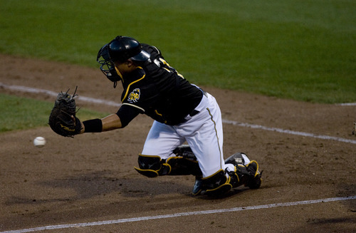 Kim Raff   The Salt Lake Tribune Salt Lake Bees catcher Hank Conger misses a throw to home as Oklahoma City Redhawks score a run during a game at Spring Mobile Ballpark in Salt Lake City, Utah on August 6, 2012.