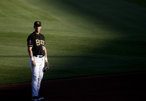 Kim Raff | The Salt Lake Tribune Salt Lake Bees player Ed Lucas stands on the field as the sun sets during a game against the Oklahoma City Redhawks at Spring Mobile Ballpark in Salt Lake City, Utah on August 6, 2012.