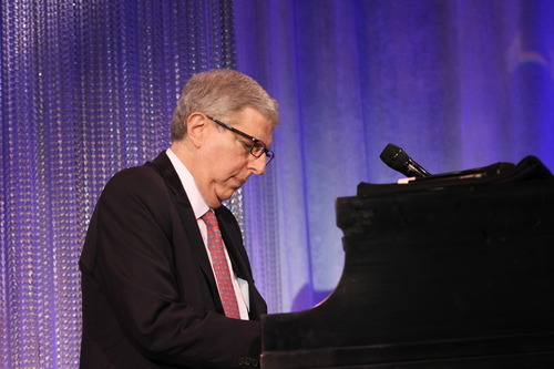 FILE - In this Nov. 8, 2011 file photo originally released by Cedars-Sinai Medical Center, composer Marvin Hamlisch performs at the Cedars-Sinai Board of Governors Gala at The Beverly Hilton Hotel in Beverly Hills, Calif. Hamlisch, a conductor and award-winning composer best known for the torch song