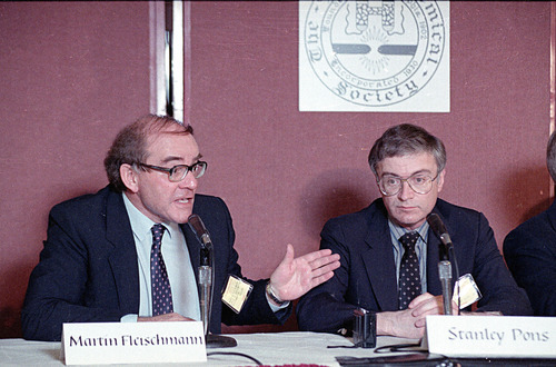 Martin Fleischmann, left, of the University of Southampton, England, talks to reporters about cold fusion as University of Utah chemist B. Stanley Pons listens, in Los Angeles, May 9, 1989.  The pair of scientists claim they have achieved nuclear fusion at room temperature.  (AP Photo/Doug Pizac)