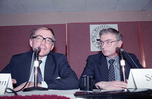 Martin Fleischmann, left, of the University of Southampton, England, talks to reporters about cold fusion as University of Utah chemist B. Stanley Pons listens in Los Angeles, May 9, 1989.  The pair of scientists claim they have achieved nuclear fusion at room temperature.  (AP Photo/Doug Pizac)