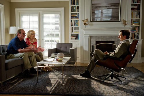 This film image released by Columbia Pictures shows Tommy Lee Jones as Arnold Soames, left, Meryl Streep as Kay Soames and and Steve Carell as Dr. Bernard Feld, right, in a scene from