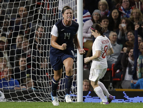 The United States' Abby Wambach, celebrates after she scored her penalty goal during the semifinal women's soccer match between the USA and Canada at the 2012 London Summer Olympics, in Manchester, England, Monday, Aug. 6, 2012. (AP Photo/Hussein Malla)
