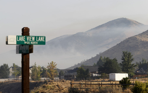 Al Hartmann  |  The Salt Lake Tribune   Smoke hangs in the air in the evacuated neighborhood in north Eagle Mountain from the Pinyon Fire Tuesday, Aug. 7.