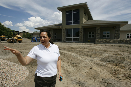 Francisco Kjolseth     The Salt Lake Tribune Ofa K. Moeai points out the features of the new Pacific Heritage Charter School that will open Sept. 5 on Salt Lake City's west side. The school's target audience will be 450 Polynesian students in grades kindergarten through 8. Pacific Island culture and language will be taught in addition to core classes. The school is the first of its kind in the state.