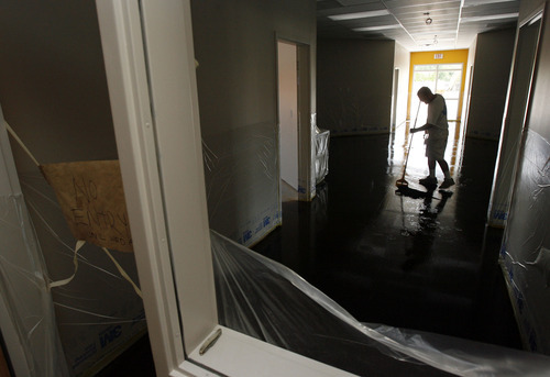 Francisco Kjolseth     The Salt Lake Tribune Crews stain concrete as they race to be done in less than one month on the new Pacific Heritage Charter School, which will open on Salt Lake City's west side. The school's target audience will be 450 Polynesian students in grades kindergarten through 8. Pacific Island culture and language will be taught in addition to core classes. The school is the first of its kind in the state.
