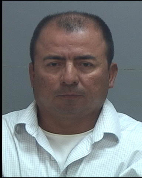 Efrey Guzman, 46, a former LDS Branch president in Sandy, is accused of biting another man's penis during an altercation. Courtesy of the Salt Lake County jail