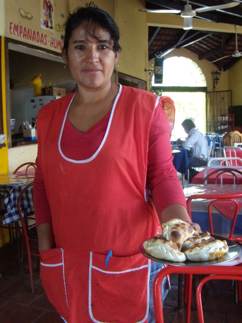 Christopher Smart | The Salt Lake Tribune  Cinthia Georgina Lopez offers up spicey beef empanadas at Plaza de Empanada in Salta, Argentina, where the tasty turnovers have been raised to an art form.