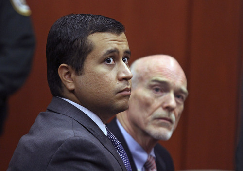 FILE - In this June 29, 2012 file photo, George Zimmerman, left, and attorney Don West appear before Circuit Judge Kenneth R. Lester, Jr.  Friday, June 29, 2012, during a bond hearing at the Seminole County Criminal Justice Center in Sanford, Fla.   Zimmerman will try to have the murder charge dismissed under Florida's