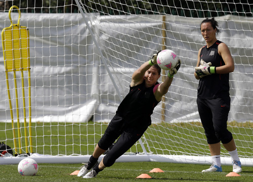 Lefteris Pitarakis | The Associated Press Hope Sol, left, and Nicole Barnhart practice Wednesday in advance of the United States' gold medal game against Japan on Thursday.