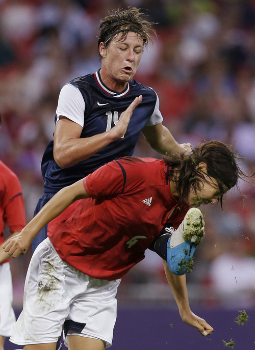 United States' Abby Wambach and Japan's Saki Kumagai collide as they pursue the ball during the women's soccer gold medal match at the 2012 Summer Olympics, Thursday, Aug. 9, 2012, in London. (AP Photo/Ben Curtis)