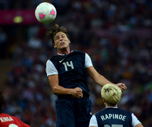 USA's Abby Wambach (14) heads the ball against Japan in the first half of their game for the Women's Football Gold Medal Match at Wembley Stadium for the London 2012 Olympics in London, England on Thursday, Aug. 9, 2012.  (Nhat V. Meyer/Mercury News)