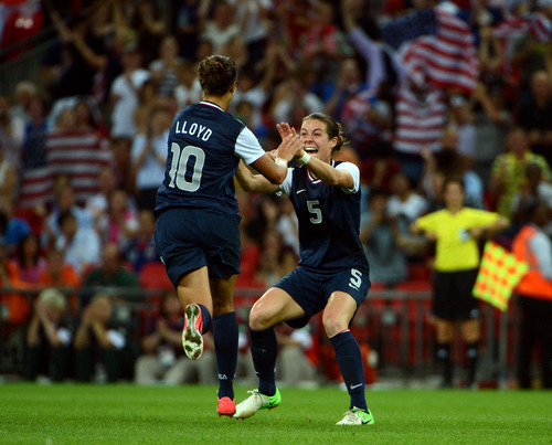 USA's Carli Lloyd (10) celebrates her second goal with Kelley O'Hara (5) in the second half of their game against Japan for the Women's Football Gold Medal Match at Wembley Stadium for the London 2012 Olympics in London, England on Thursday, Aug. 9, 2012.  (Nhat V. Meyer/Mercury News)