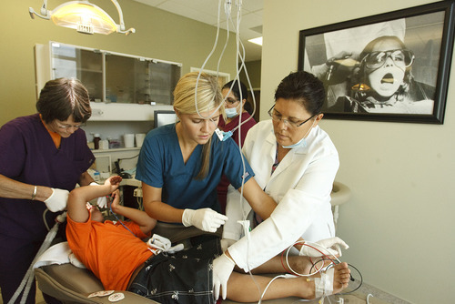 Leah Hogsten  |  The Salt Lake Tribune Anesthesiologist Dr. Julie Dobell (left) helps remove ventilator tubing as nurse Ashley Kirkland (center) and assistant Isabel Castro wake up Iraqi immigrant Hussien Alsaedi,their 6-year-old patient from receiving 10 fillings, 1 crown and an extraction. Donated Dental Services of Salt Lake City provides sedation one day a month for kids where they can get multiple dental needs met all at once.